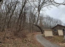 37.76+/-acres already set up for off the grid living with 2 cabins.